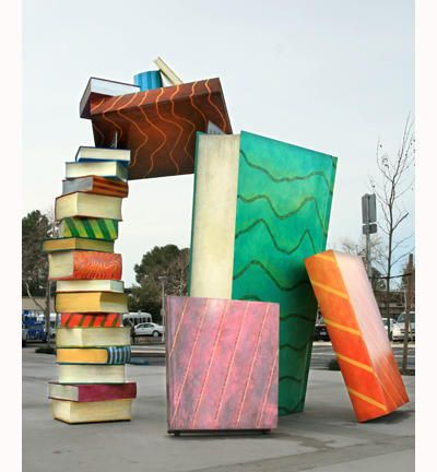Tower of books sculpture by Joseph Bellasera at the West Sacramento Library, California - photo from readitforward blog