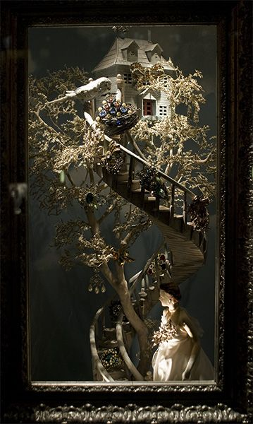 bergdorf goodman window display. Who wouldn't want a dollhouse at the top of a spiral staircase?