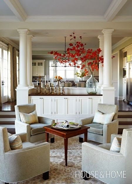 Love the design of how the kitchen opens up to this family room