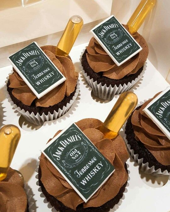 Jack Daniel's cupcakes with spiked ganache, icing and pipette of JD