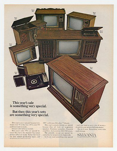 TVs in wooden cabinets.