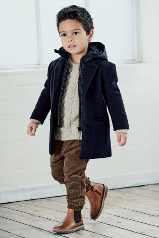 This kids nailed smart-casj dressing for the winter months with this knitwear and commuter jacket combo!