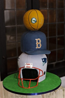 Lose the baseball hat and make the helmet and basketball UCLA, small Joe Bruin on top or at the base on the side.
