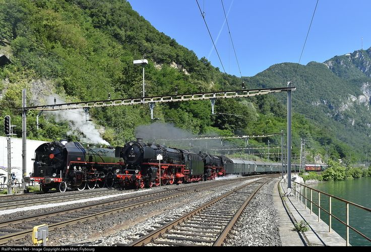 "Along the beautiful Lugano Lake, one of the trains of the Gotthard Steam Show (Dampflok-Spektakel am Gotthard) arrives in Melide behind two ""01"" German Pacifics while the French, American-built, Swiss-owned, oil-fired 141R 1244 waits to take the rear-end helper position. Many thanks to Georg Trub for providing me the detailed timetables for this event."