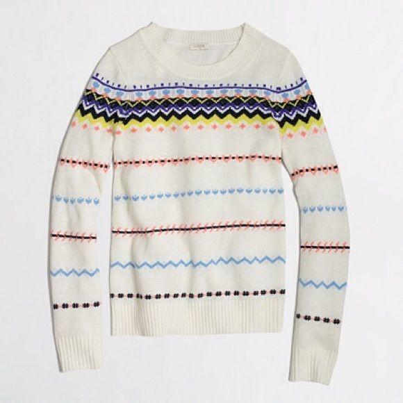 J Crew ZigZag Fairisle Pullover Sweater J Crew Factory Sweater. Small. Style #B3872. Length: Approximately 25 inches. Approximately 17.5 inches from armpit to armpit. Sleeve length: Approximately 24 inches from shoulder seam to wrist. Fairisle, zigzag print. Ribbed cuffs and hems. 37% Viscose, 35% Nylon, 28% Merino Wool. J. Crew Sweaters