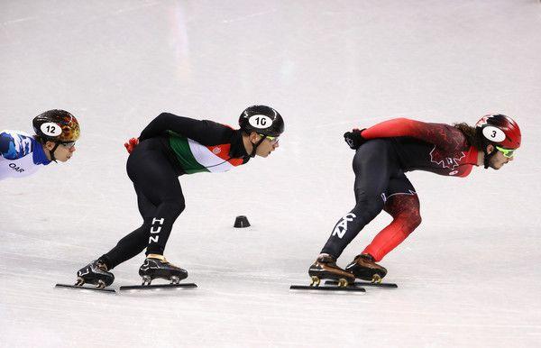 DAY 1: Men's Short Track Speed Skaing 1500m - Semen Elistratov of Olympic Athlete from Russia, Shaolin Sandor Liu of Hungary and Samuel Girard of Canada