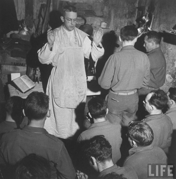 Mass held by Chaplain Leo J. Crowley for US infantry men engaged in attacks on German fortification positions at the Italian front. Loiano, Italy 1945.