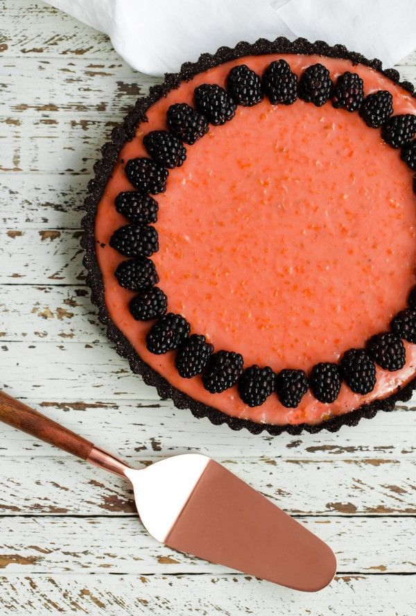 Triple-citrus tart with chocolate crust and berries. This elegant tart is made with a dark chocolate wafer crust and filled with blood orange, lemon, and lime curd.