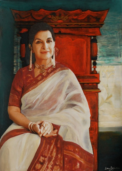 """Sushma  Seth is wearing an eye-catching Benarasi saree and vintage pearl and diamond jewellery and the portrait   captures her natural elegance so well."""