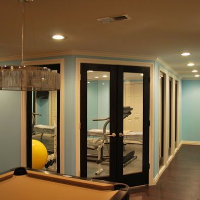 Basement remodel-add a window with curtains to one of the bedroom walls to make it seem more open.