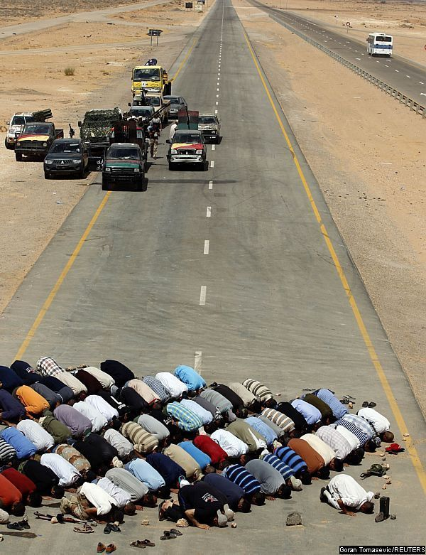 An incredibly powerful picture... Libyan rebels taking a prayer break. May God protect them!