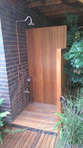 Rustic outdoor shower in copper