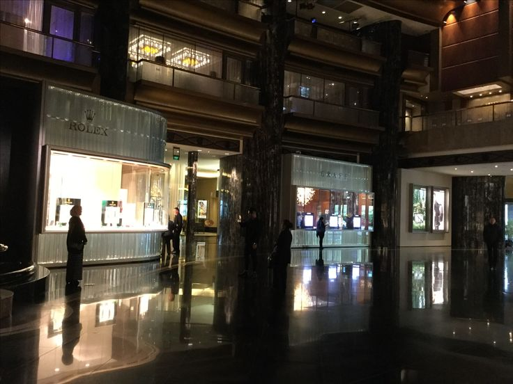 Photo 3: Crown Casino, the Atrium uses marble tiles juxtaposed glass wall covering highlighting retail glamorous icons.