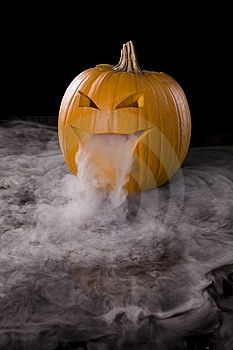 Dry ice in a jaco-o-lantern, add a green glowstick to make it