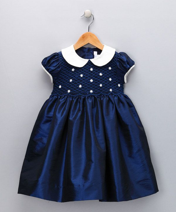 Take a look at this Navy & Ivory Daisy Smocked Dress - Infant, Toddler & Girls on zulily today!