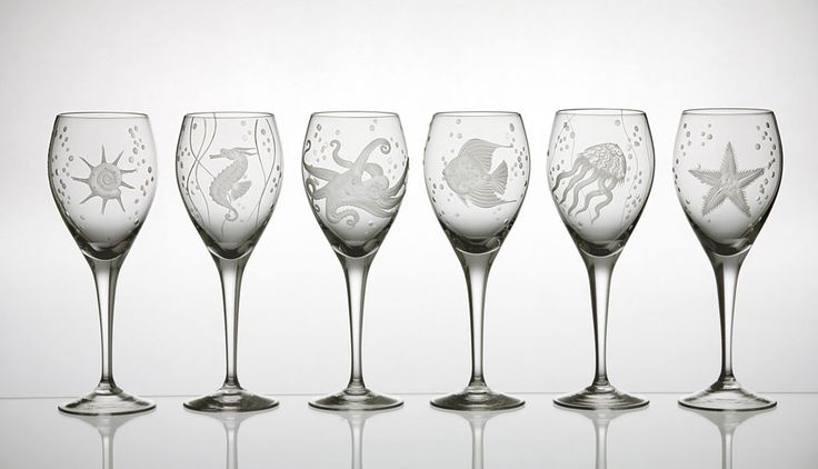 Marine Life Wine Glasses.  Hand engraved and mouth blown, each with a different item of sea life.