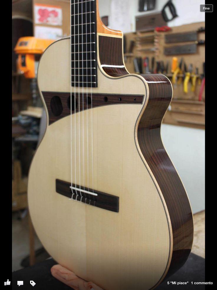 Acoustic Guitar with unique soundhole. More info please