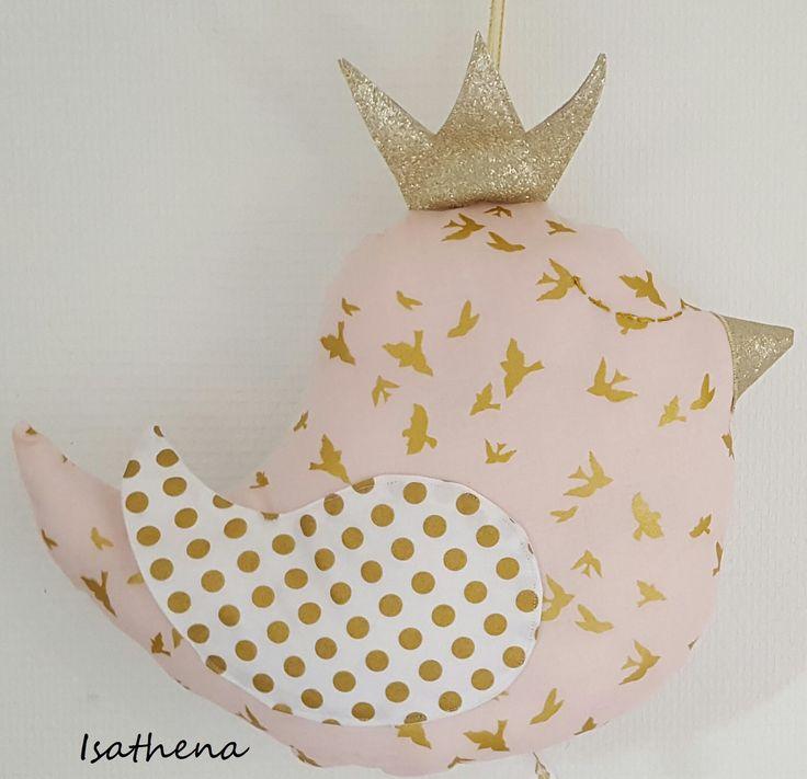 Oiseau doudou musical imprimé de petits oiseaux dorés