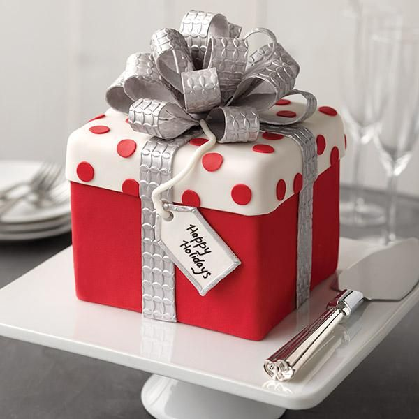 This adorable cake is ready for giving or for any holiday celebration. Wouldn't this gift box cake make a great hostess gift with its glimmering multi-loop bow?