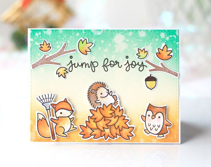 I used Lawn Fawn Jump for Joy stamp set and coloring the images with Zig Clean Color Real Brush markers. For the background I used distress inks in shades Evergreen Bough and Carved Pumpkin.