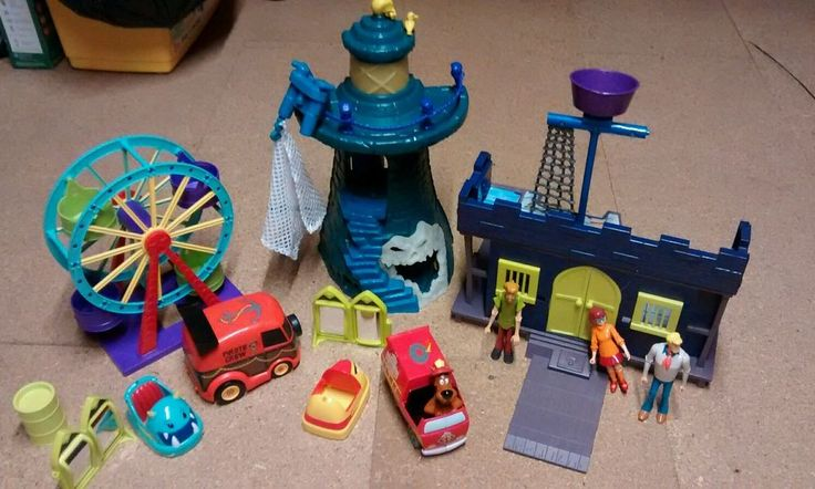 Lighthouse, make spooky sounds and lights up. Castle, 2 cars, fair ground rides, 3 figures and goo.  In very good condition except for white mark across castle door, please see photos.  Pet and smoke free home.  Collection only. Irlam  Thanks for looking.   eBay!