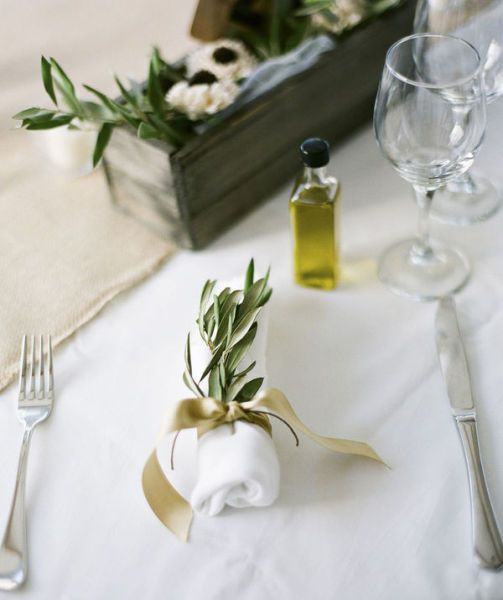 Grecian wedding table - Olive branch and a small bottle of keepsake olive oil for a Greek themed #wedding.