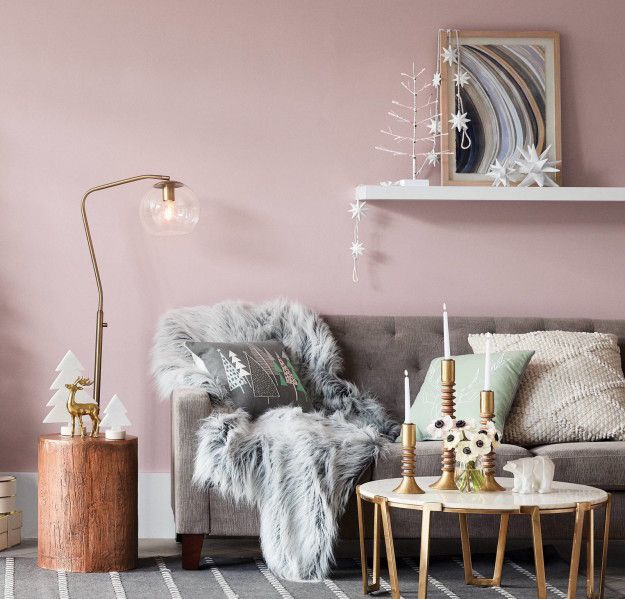 Or turn your house into a cozy oasis by piling fuzzy and knit accessories onto your existing decor. | 18 Cheap Ways To Decorate For The Holidays
