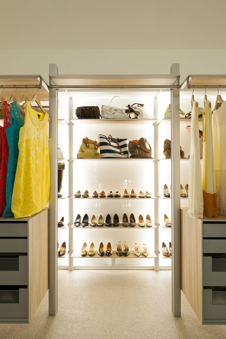 How to store shoes, pumps and handbags in a modern walk-in closet. see