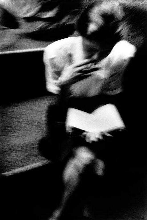an office worker in pitt street mall reads a book in the lunch hour, sydney, australia, 1999 photo by trent parke/magnum photos