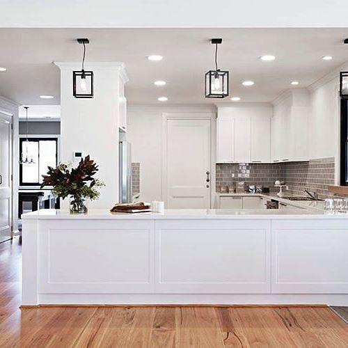 Dark splashback with white kitchen