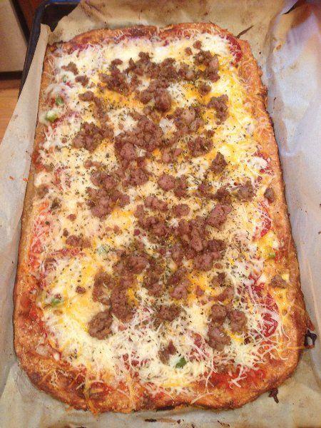 My favorite low-carb pizza crust - mozzarella, almond flour, eggs. (Photo shows a doubled recipe)