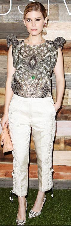 Kate Mara: Shirt and pants – H&M  Purse – Burberry  Earrings – Jacquie Aiche