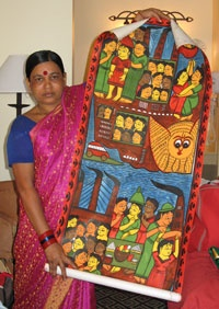 Bengali artist Rupban Chitrakar with her story scroll which tells the story of the Titanic