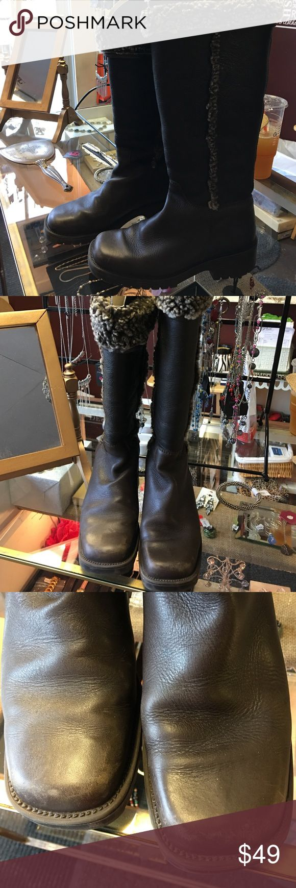 LL BEAN Leather and shearling boots Gorgeous soft leather boots in chocolate brown trimmed with curly shearling . Can be rolled down to make a shorter boot. Adorbs!!! LL Bean Shoes Winter & Rain Boots