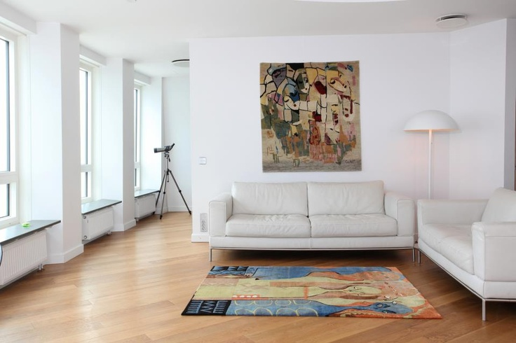 "Sam Ovraiti's ""Women of Honour"" (on wall) and Tola Wewe's ""Family"" bring this living space so nicely together. #rug #interiordesign Check out our website for  more of our collection. http://africaonthefloor.com/"