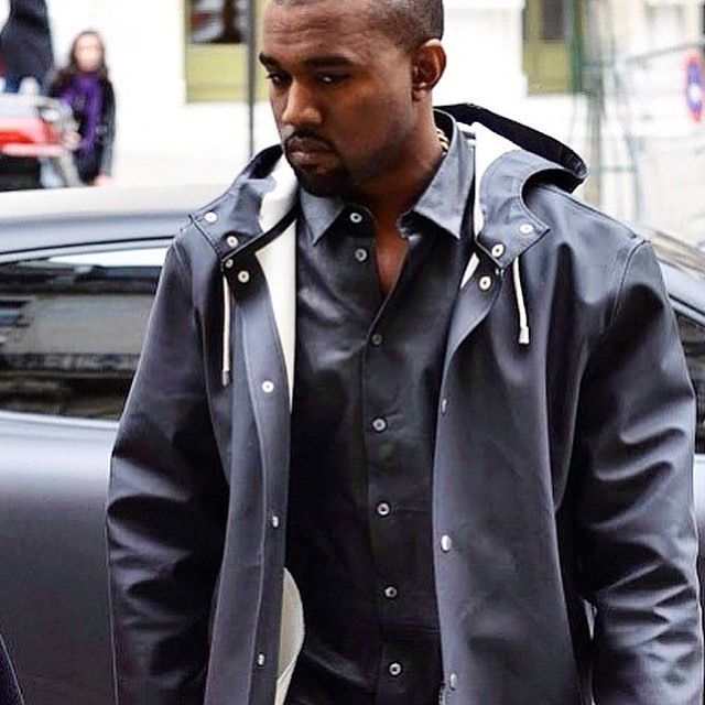 #tfw it rains all month and you still don't have a raincoat. Kanye in Stutterheim Navy Raincoat. Click the link in our bio to shop our @stutterheim and @rainsjournal raincoats online // www.gotstyle.com #kanyedoingthings