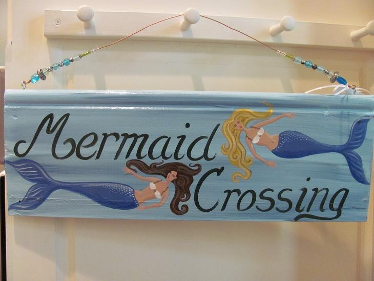 Mermaid crossing painted on salvaged wood.