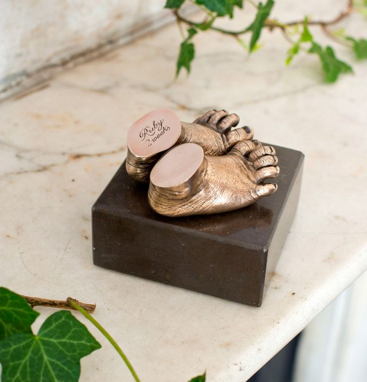 Polished bronze cast baby feet . I will have this done for my baby.