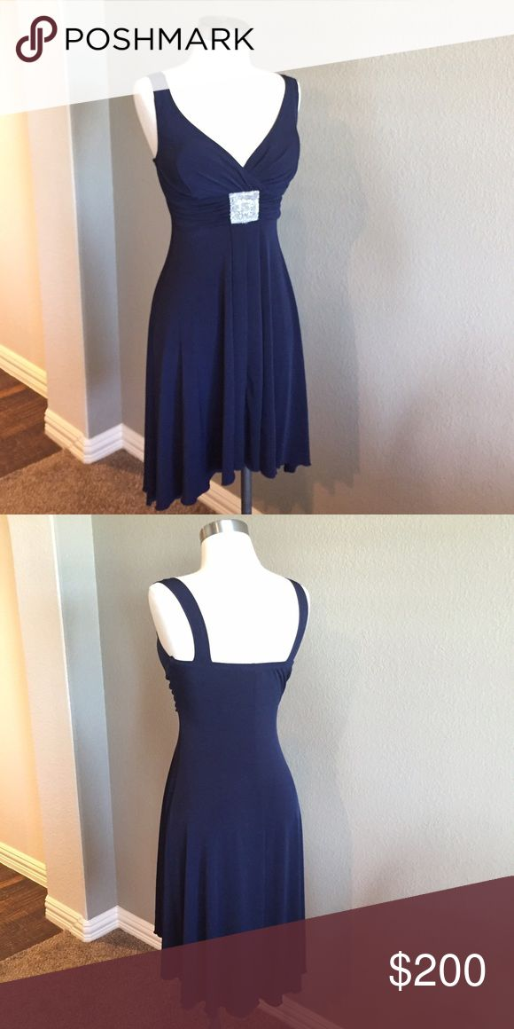 """V-Neck High-Low Navy Petite Dress Sophisticated and classic. Stretchy, so it hugs your curves in all the right places. 95% Polyester/ 5% Spandex. Lightly padded bust. Size 4p. Worn once for a few hours only. Would look fabulous with silver shoes and accessories I also have available.   Approximate Measurements (unstretched, laid flat):  Bust (armpit to armpit) - 12.5"""" Waist - 12.5"""" Hips- 20"""" Length in back - 39.5"""" Length in front - 33"""" Dresses High Low"""