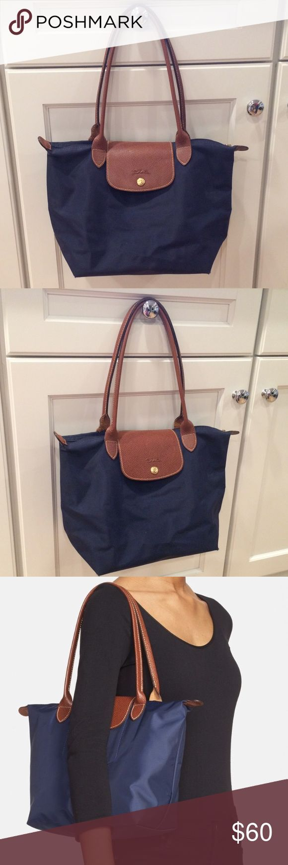 Shop Women s Longchamp Blue size OS Totes at a discounted price at Poshmark.  Classic Longchamp bag with inside pocket. In good condition! 0c26be4e08