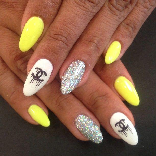 Neon Yellow Chanel nails