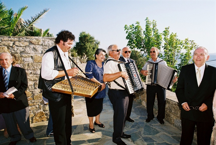 Mykonian traditional instrument players performing before wedding ceremony - Mykonos Grand Hotel & Resort