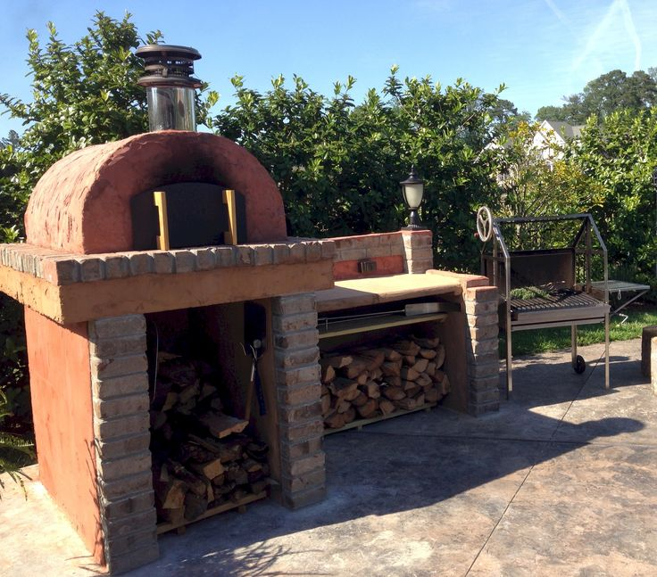 This Outdoor Kitchen includes the Cortile Barile Outdoor Pizza Oven and a Wood-Fired Argentinian BBQ Grill - And a nice little prep area to put it all together!  BrickWoodOvens.com