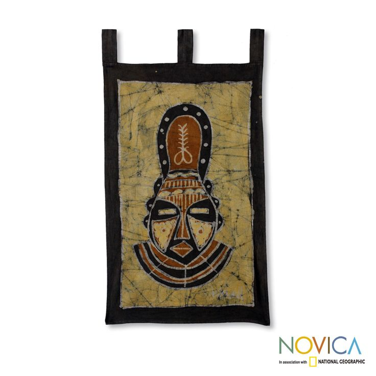 Shades of yellow, black and brown define an African mask on this handcrafted wall hanging. K. Baka expertly works in batik on cotton to craft a wall hanging that features an adinkra symbol known as 'aya', a fern meaning endurance and resourcefulness.