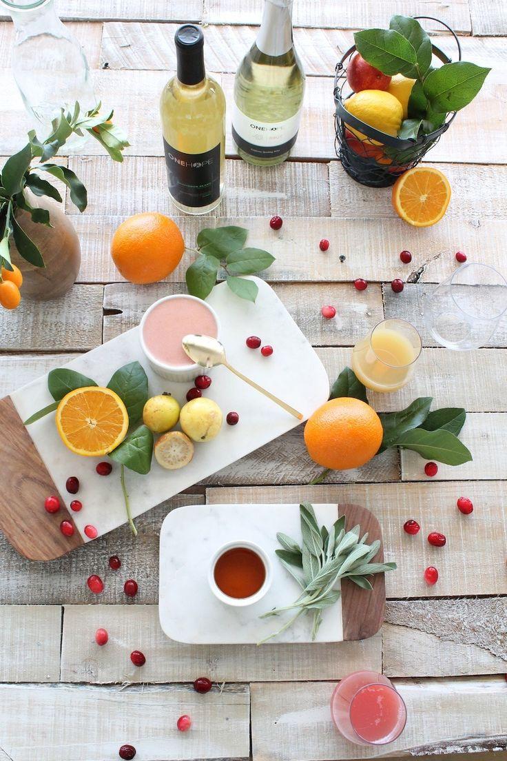 Guava Sangria - sauvignon blanc - sparkling wine - cognac - guava puree - pear juice - cranberry juice - orange wedges - cranberries - sage leaves