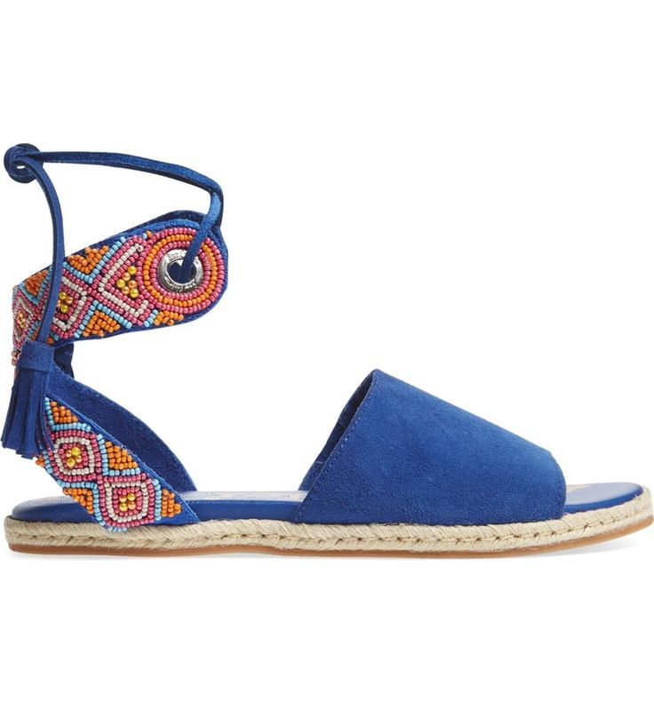 Bright, beaded, and bold these suede  sandals scream 'summer time'