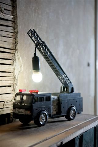 With a lighting kit, a tonka truck and some spray paint, I could definitely make this! Great present for a little boys room.