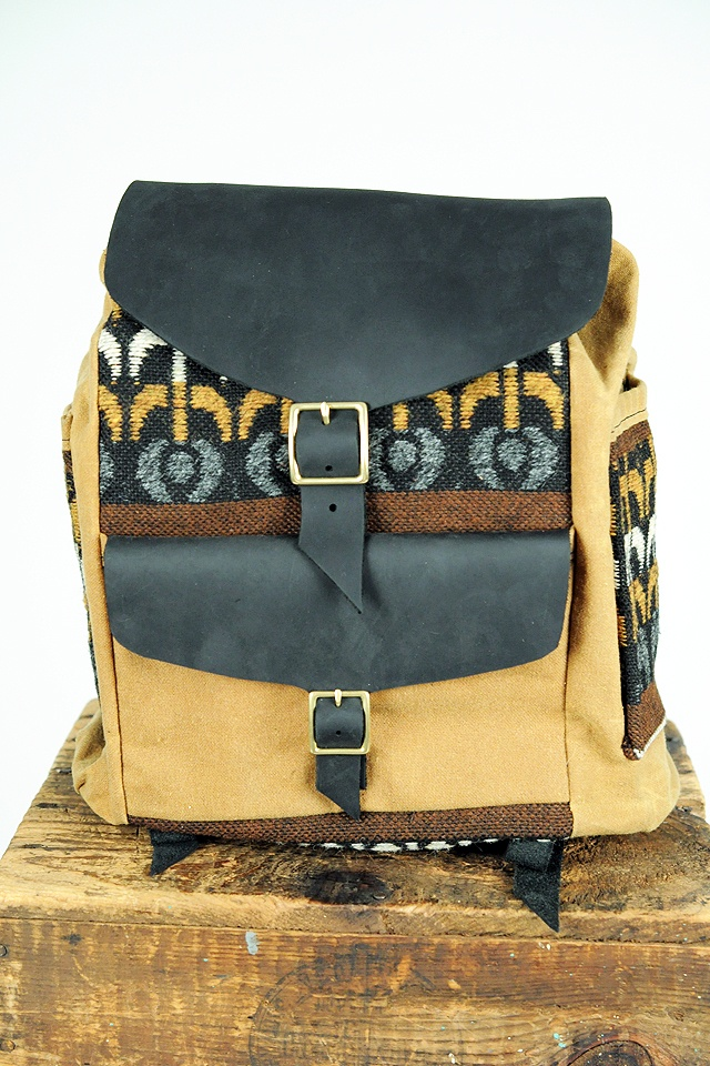 I totally drew up a sketch for a backpack like this! Now I just need time to make it...