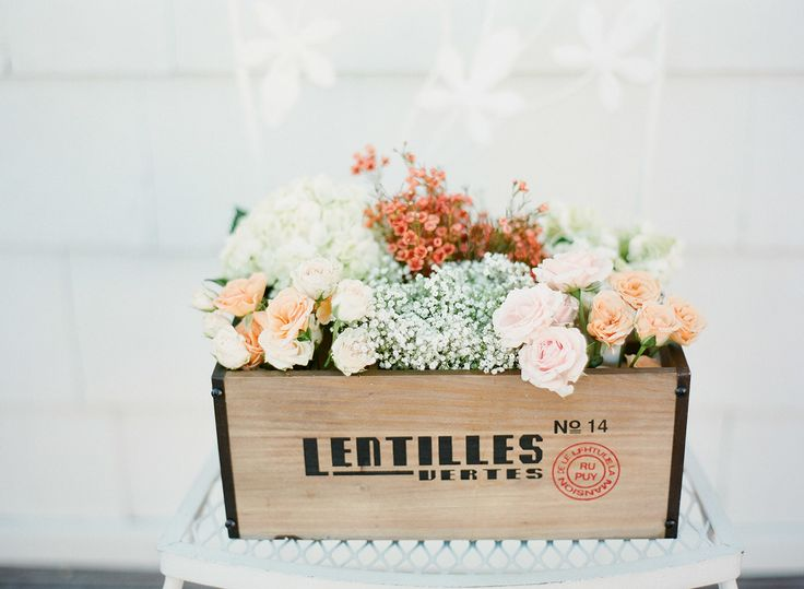 Lots of cute wedding flower ideas in this wedding on SMP: http://www.StyleMePretty.com/2014/03/14/pastel-wedding-at-the-old-field-club/  Laura Ivanova Photography