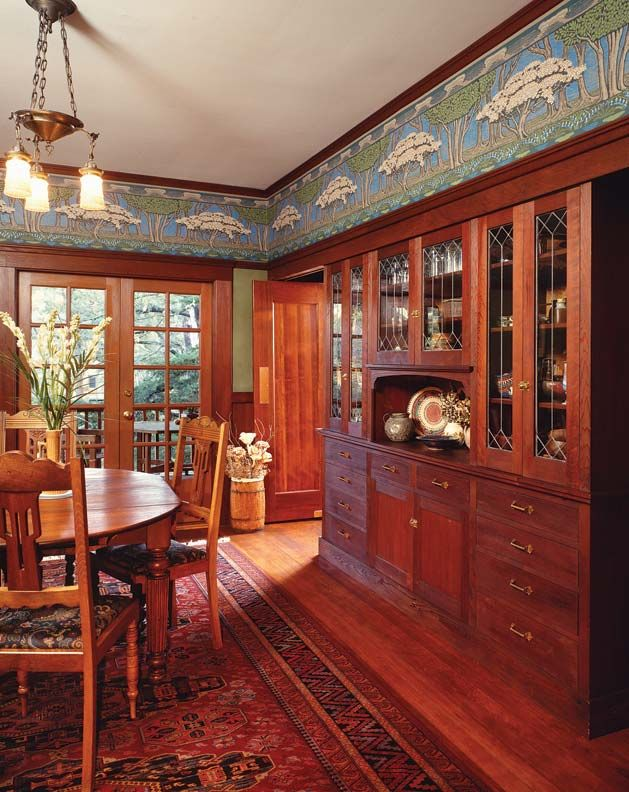 Arts & Crafts dining room with built-in china cabinet and wallpaper frieze - photo: Douglas Keister